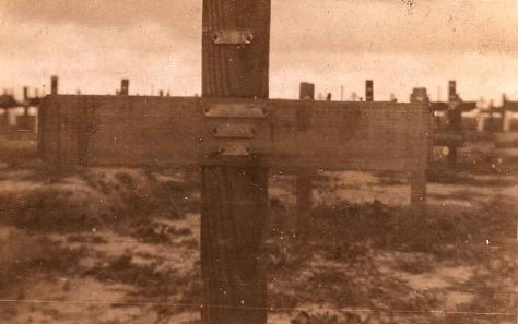"NO MAN'S LAND, CEMETERY FONQUEVILLERS:  WOODEN CROSS inscribed: "" Unknown Sergeant, S. Stafford"". Photo: Basil Hibbett 1920."