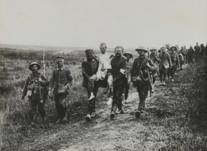 British Soldiers carry German wounded.